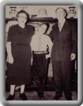 Chuckie (age 16) with parents, Adolph and Lena dressed up for sister's engagement party